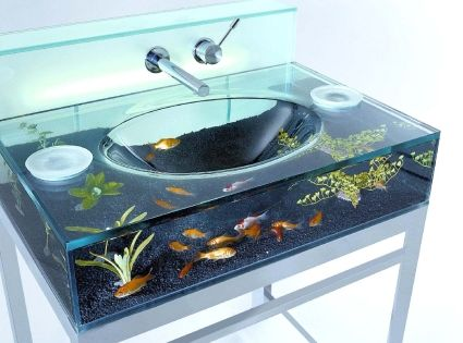 Fish tank inside the bathroom sink? How cool is this? I wonder
