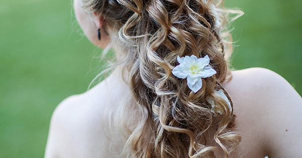 A Tangled-inspired wedding updo. I really liked Rapunzel's hair in tangled