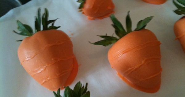 Chocolate covered strawberries (carrots) for Easter. Orange dyed white chocolate dipped strawberries.