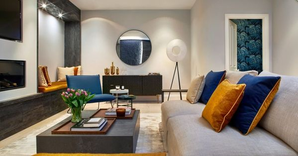 The Accents Of Navy And Burnt Ochre Are Continued Downstairs To Give The House Flow Navy Living Rooms Ochre Interiors Interior Design Gallery