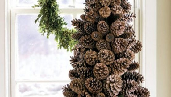 tree pine cone Create a pinecone tree on a cone-shaped foam base.