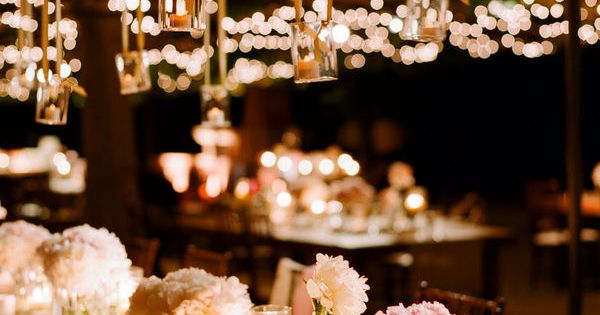 :: Table setting at night. Low, simple flower arrangements + candlelight |