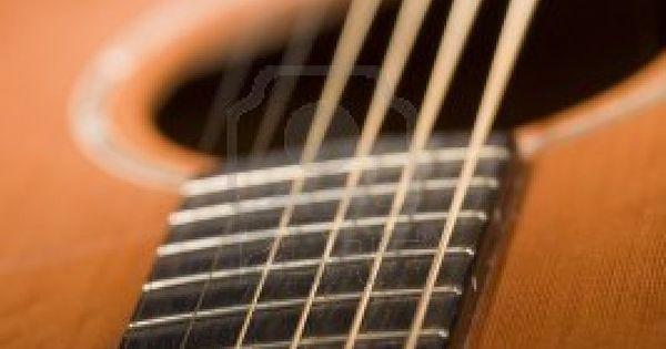 vibrating string up of acoustic guitar with vibrating strings focus on fretboard. Black Bedroom Furniture Sets. Home Design Ideas