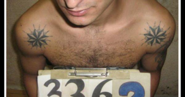 Russian criminal tattoo photos meanings of tattoo vor v for Russian mafia tattoos