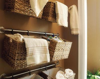 Practical Bathroom Storage Ideas - hang baskets off towel rack