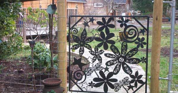What a whimsical garden gate! Flower power!