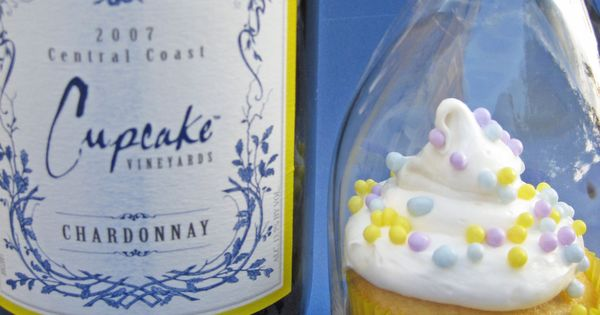 good idea for a party...everybody gets a cupcake and a wine glass.