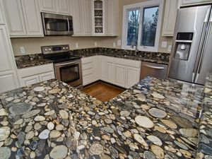 Wow Designing With River Rock And Black Mosaic Gold Granite
