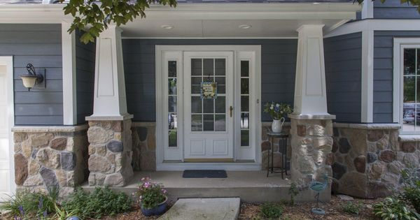 Inviting elegant entry on blue house with stone accents
