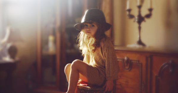 Beautiful little girl, love her hat and the light.