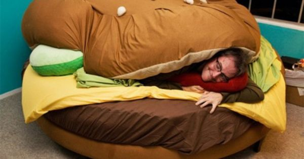 Hamburger bed! That is just awesome. I wonder if he dreams of