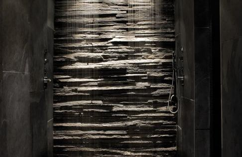 This could be done with vertical concrete to look like stacked stone!