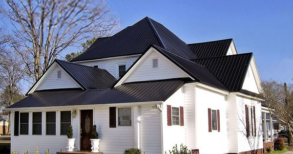White exterior with black metal roof house colors for Black roof house