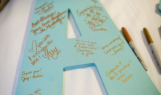 Have guests write their well wishes on large wooden initials. What a fun idea! /// Photo by Gray Photography via Project Wedding.... I know it is says wedding but this would be cute for a baby shower too. Just to show the lil one how much they are loved e...
