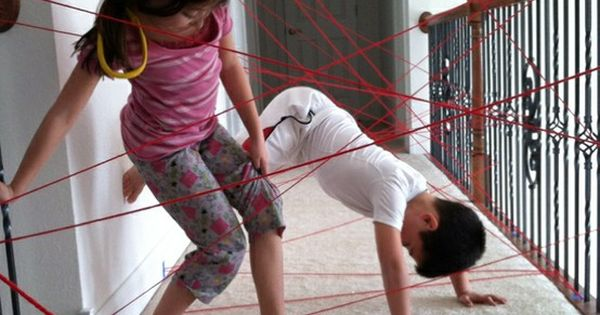Rainy day fun :: game for kids :: Tape yarn across a