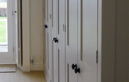A Bank Of Fitted Wardrobes Hand Made And Painted In