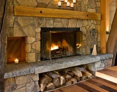 Exposed brick fireplace with indian stone hearth and reclaimed