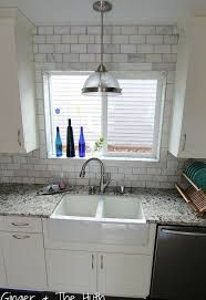 Subway Tile Around Window Sill The Use Of This Beautiful Double Butler Sink And White Metro Tiles Creates Kitchen Window Sill Shaker Kitchen Tiled Window Sill