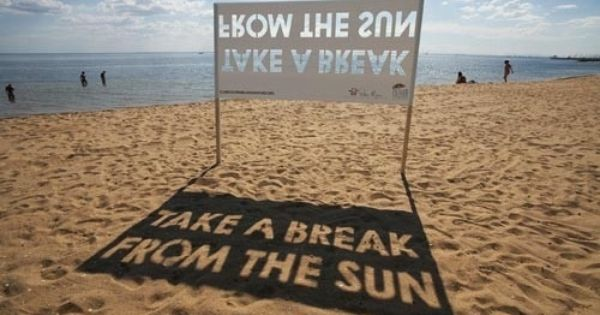 """Take a Break From The Sun"" beach sign. The message is created"