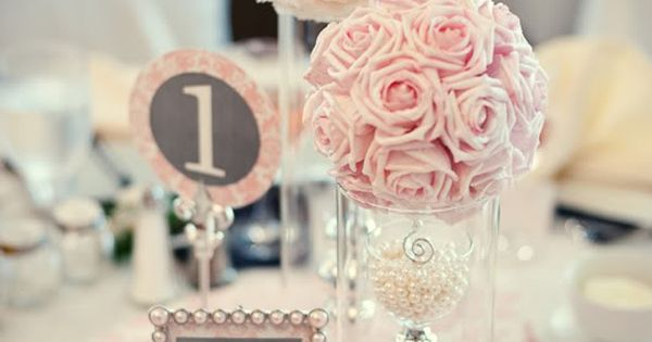 pearl and lace wedding centerpieces... these flower balls are really easy to