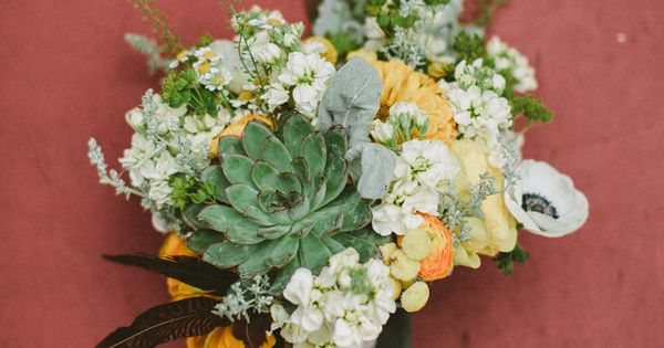 bouquet with succulents   feathers // photo by Jason   Anna Photography, flowers by Steven Bruce Design // http://ruffledblog.com/woodsy-catskills-wedding