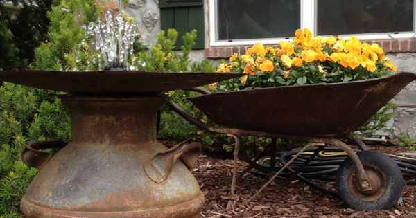 Easy fountain recirculating water in an old milk can and for Recirculating water feature