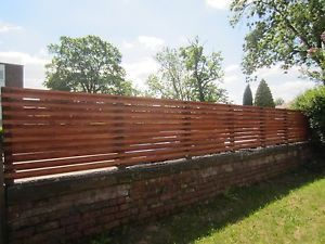 Wooden Slatted Fencing To Be Attached On Top Of A Garden Wall Rock Wall Fencing Garden Wall Fence Landscaping