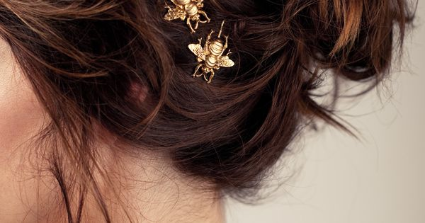 Golden bumble bee bobby pins, perfectly at home nestled in a messy