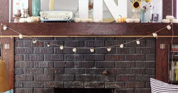 The dark wood stained mantel is the perfect grounding for a light