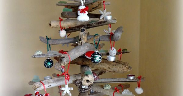 diy driftwood christmas tree with many diy ornamants