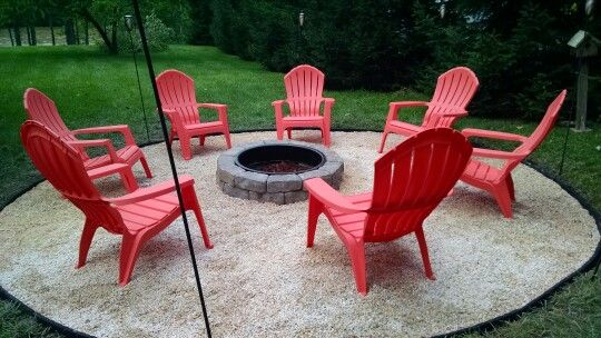 Fire Pit With Pea Gravel And Lowes Adirondack Chairs I Added Tiki Torches Around The Outside Outside Fire Pits Outdoor Fire Pit Fire Pit Landscaping