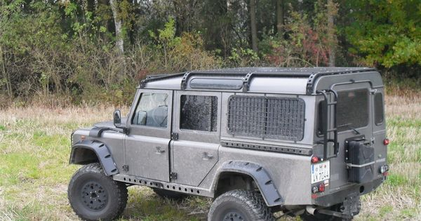 Military Looking 110 With Genesis Tracks Roof Rack And