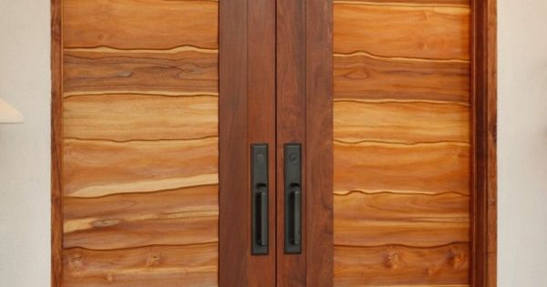 Organic front doors hand carved to flow with the natural for Natural wood front door