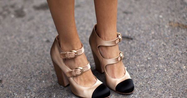 Chanel satin cap-toe pumps | Alexa Chung at Valentino Spring 2011, Paris.