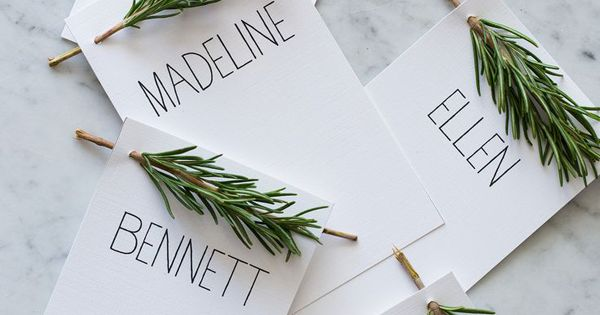 Christmas Table Placecards: Each one is decorated with Rosemary (could also use