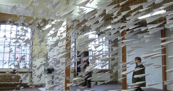 Flight, one thousand paper airplanes suspended in air. 'One Thousand Means of