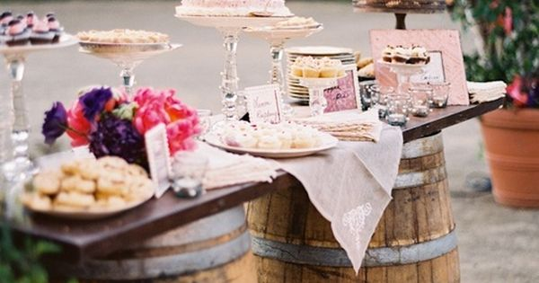 Rustic wedding beautiful dessert bar | wine barrel table