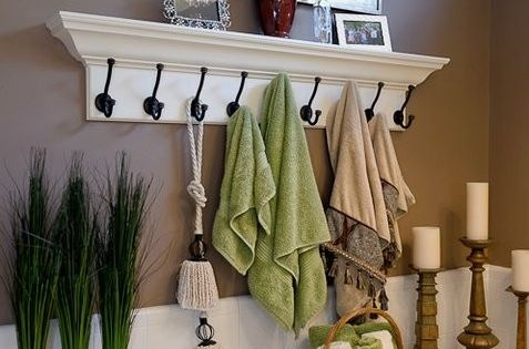 skip the towel rod...I love this. Its always hard to decorate around