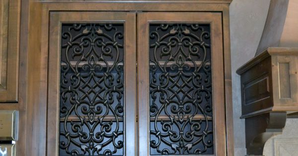 Kitchen cabinet doors with faux iron inserts from faux - Wrought iron kitchen cabinet door inserts ...
