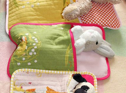 Pot holders as play baby doll beds..