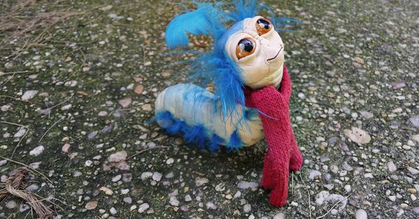 @Kirstie Myers Labyrinth worm! Materials: sculpey, feather, and sock.
