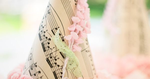 pretty party hats made from vintage sheet music and tissue paper