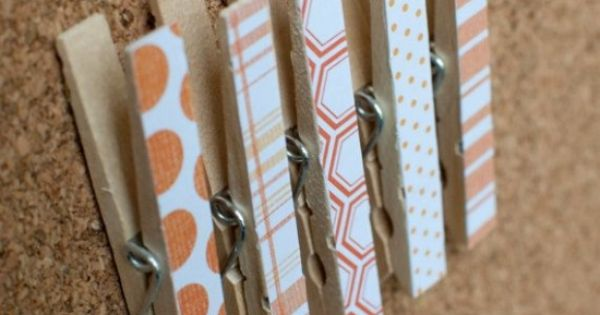 Clothespins, push pins, scrapbook paper, + hot glue = an incredibly EASY