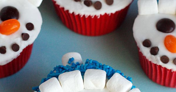 Snowmen cupcakes. Decorate with mini chocolate chips for the mouth, jelly beans