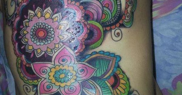 Beautiful paisley tattoo. Absolutely gorgeous - the colors are incredible.