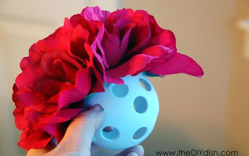 Easy way to make hanging flower balls. Wiffle balls from dollar store,