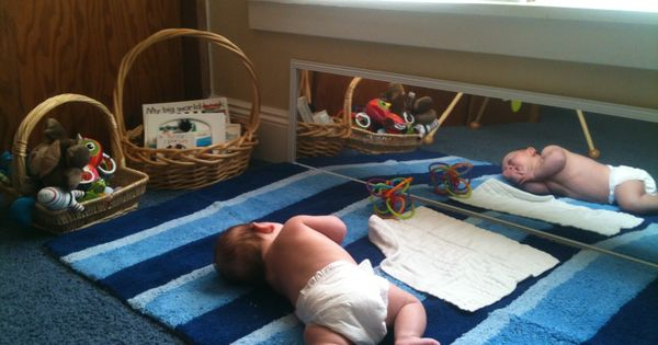 Montessori Movement Area For An Infant Which Includes A