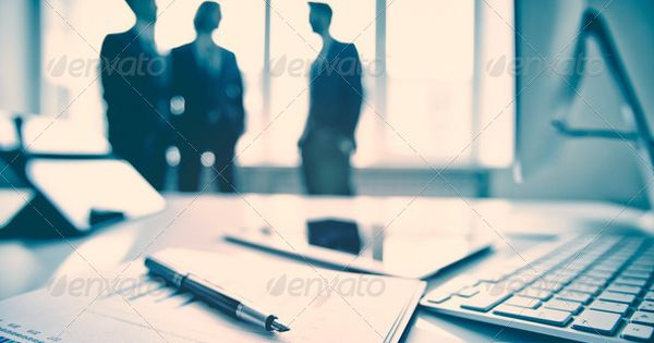 Business devices and documents at the workplace, unrecognized business people sharing the ideas