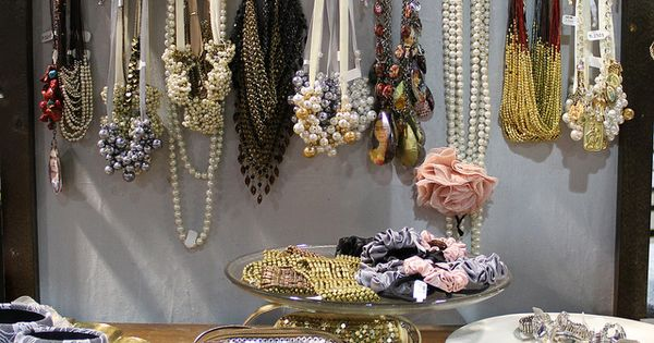 Hang necklaces on cool vintage door knobs. I