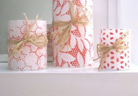 Lace candles. Cover candle with lace. Spray paint. Let paint dry and